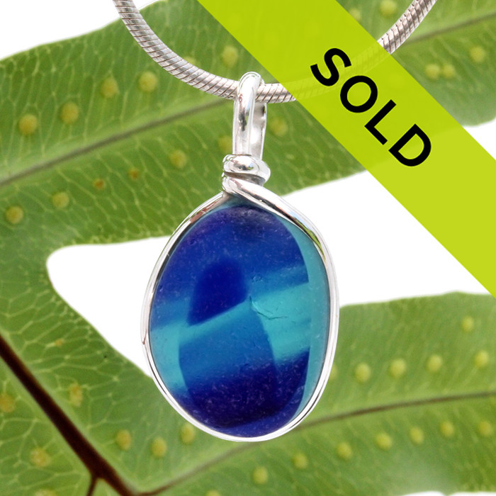 A beautiful larger piece of vivid aqua and blue green sea glass set for a necklace in our Original Sea Glass Bezel© in solid sterling silver setting.