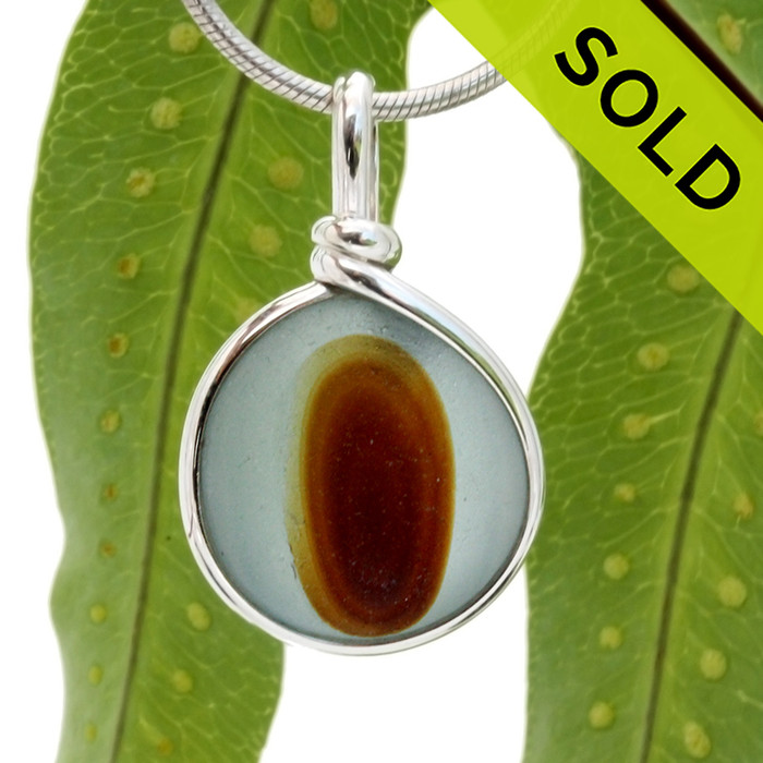 A beautiful larger piece of vivid blue green sea glass with a vivid amber center set for a necklace in our Original Sea Glass Bezel© in solid sterling silver setting. SOLD - Sorry this Rare Sea Glass Pendant is NO LONGER AVAILABLE!