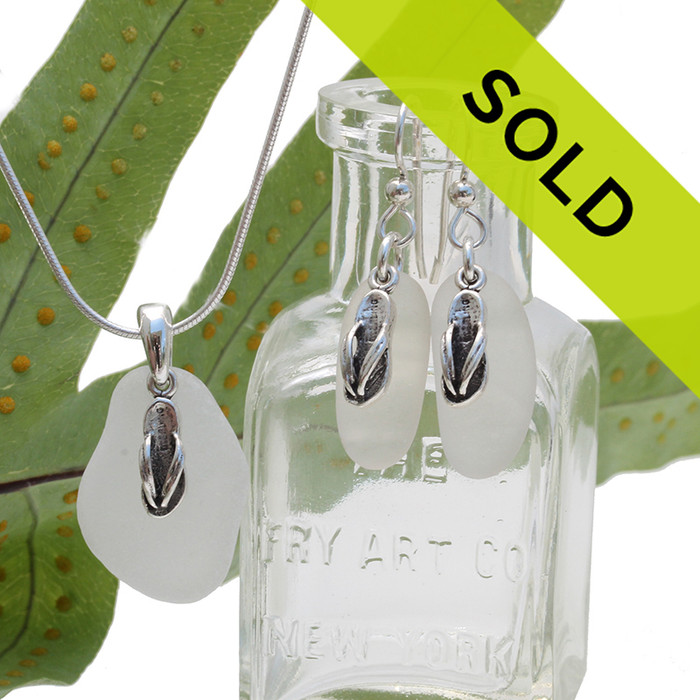 Pure white sea glass in a silver set of earring and matching pendant with silver flip flop charms. Sorry this sea glass jewelry has been sold!