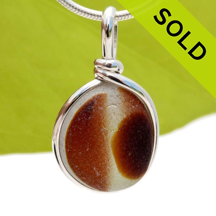 A stunning piece - This photo does not do it justice. Very 3 dimensional colors that are fused inside this 150 year old sea glass piece found in Seaham England. Sorry this piece of Sea Glass Jewelry has been SOLD