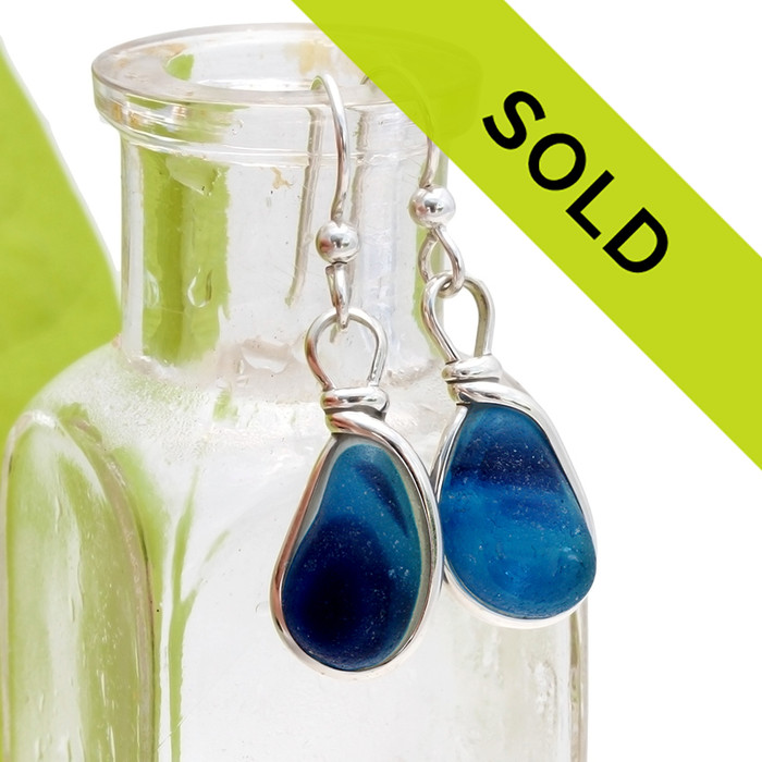Deep rich mixed cobalt blue Victorian Sea Glass pieces from Seaham England are set in our Original Wire Bezel© earring setting. This is a very hard sea glass to match and this photo is true to color, subtle variances in the blue shade can be seen.
