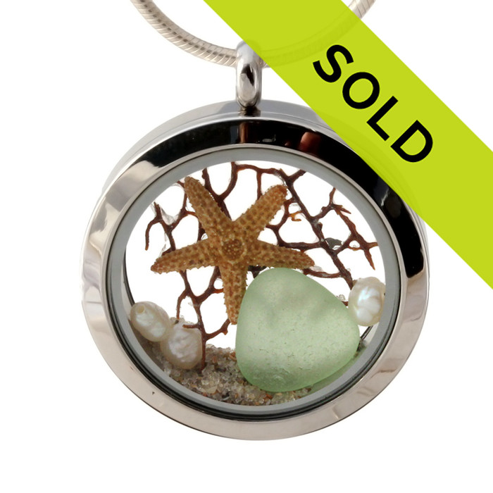 Genuine seafoam green sea glass pieces combined with a real starfish, a piece of sea fan, pearls and real beach sand in this JUMBO 35MM stainless steel locket.