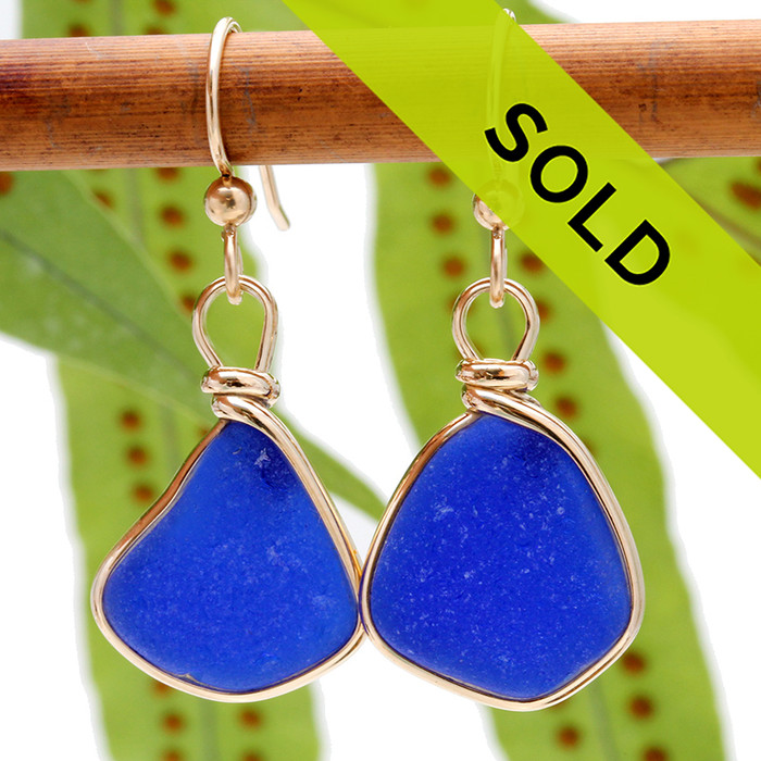 A beautiful pair of natural vivid blue beach found sea glass pieces set in our Original Wire Bezel© in a gold setting that leaves the sea glass TOTALLY UNALTERED from the way it was found. Sorry these sea glass earrings have been sold!