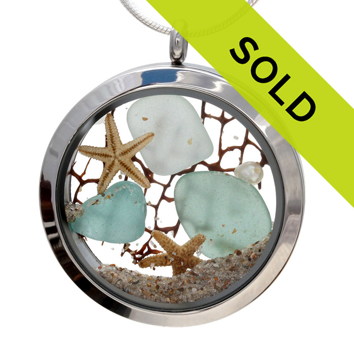 Genuine aqua and sea green sea glass piece combined with a real pearls, sea fan, starfish and a real beach sand in this JUMBO 35MM stainless steel locket.