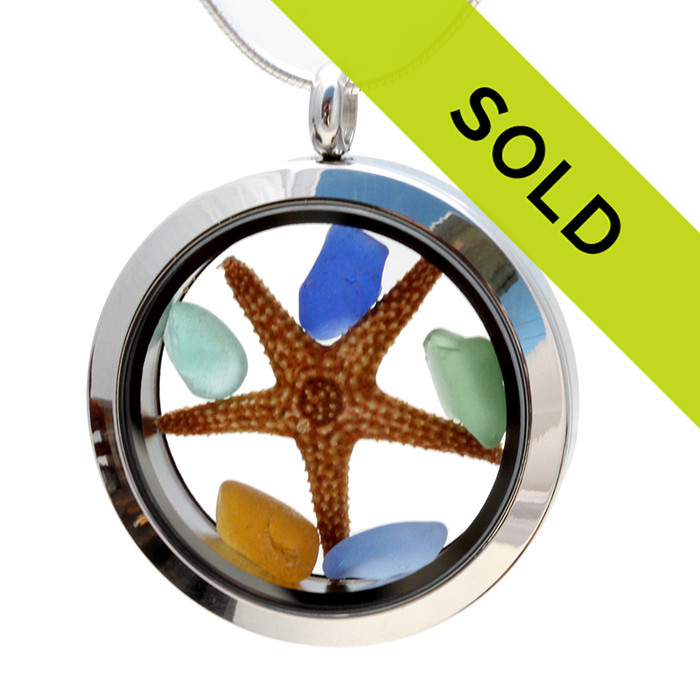 A combo of genuine sea glass pieces in blue, green and amber sea glass pieces combined with a real starfish in this sea glass locket necklace. Sorry this piece is no longer for sale.