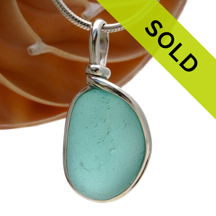 This is a great setting that leaves the sea glass piece TOTALLY UNALTERED from the way it was found on the beach in the UK!