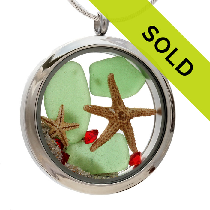 Green sea glass and vivid red gemstones finished with real starfish make this a great locket necklace for the holidays. Sorry this locket has been sold!
