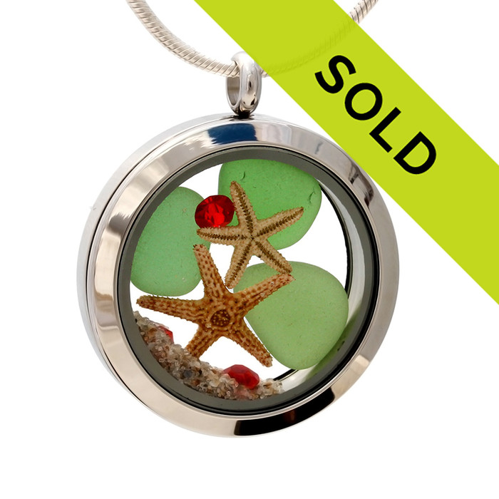 Green sea glass and vivid bright red gemstones make this a great locket necklace for the holidays. Two real starfish and beach sand complete your beachy Christmas scene!
