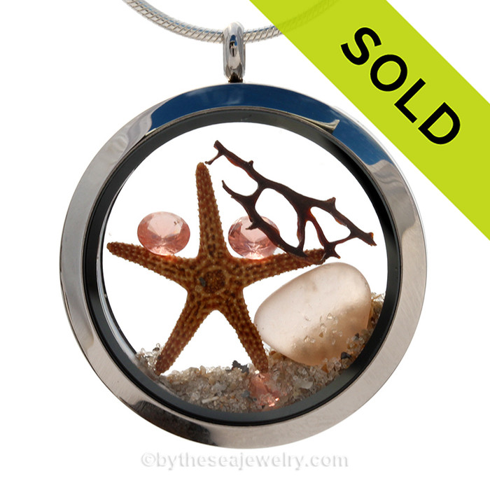 Beautiful and RARE Genuine Peach sea glass pieces combined with a real starfish and pink depression crystal gems. Finished with real beach sand in this JUMBO 35MM stainless steel locket. SOLD - Sorry this Sea Glass Locket is NO LONGER AVAILABLE!