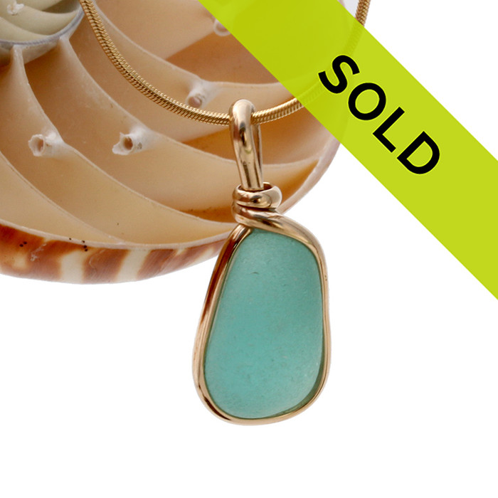 A perfect piece of aqua blue with in our signature Original Wire Bezel© pendant setting that leaves both front and back open and the glass unaltered from the way it was found on the beach. Sorry this sea glass jewelry selection has been sold!