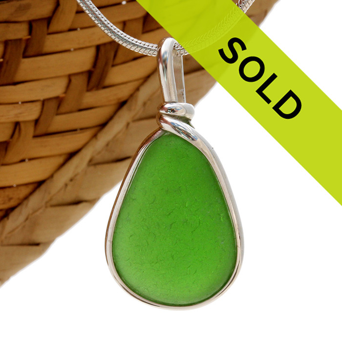 A perfect piece of Genuine UNALTERED sea glass set in our classic Original Wire Bezel© setting. Sorry this piece of sea glass jewelry has been sold!