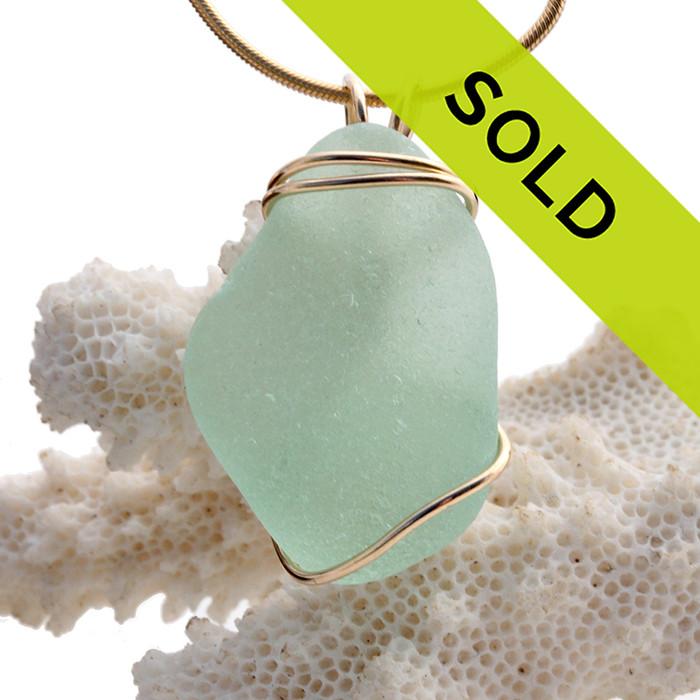 Thick Sea Green Sea Glass In Gold Triple Wrapped Pendant, a nice vivid seafoam green.