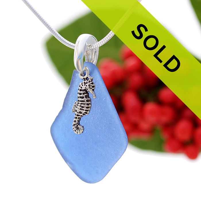 Beach found cobalt blue sea glass is combined with a solid sterling bail and finished with a S/S detailed Seahorse Charm on an 18 Inch solid sterling snake chain. Sorry this sea glass necklace has been sold!