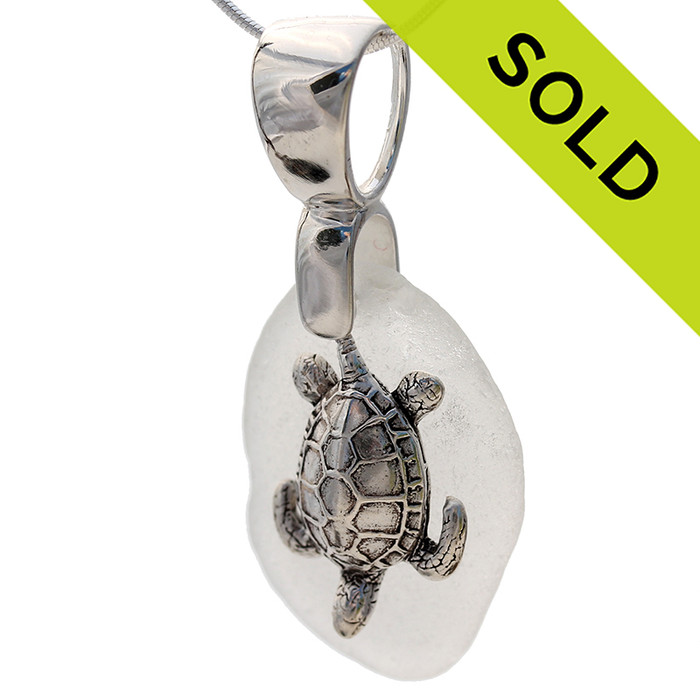 Beach found vivid large pure white sea glass is combined with a solid sterling turtle and presented on an 18 Inch solid sterling snake chain. Sorry this Sea Glass Necklace has been SOLD!