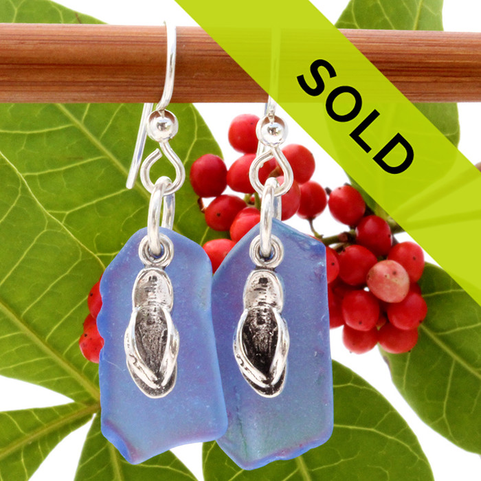 Not perfect but large blue sea glass earrings in sterling with sterling flip flop charms Sorry this pair of sea glass earrings has sold
