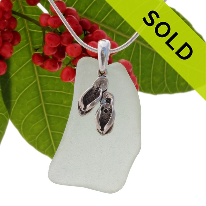 LARGE Beach found pale seafoam green sea glass is combined with a solid sterling flip flops charm and presented on an 18 Inch solid sterling snake chain. Sorry this piece of Sea Glass Jewelry has been sold!