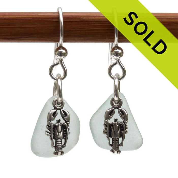Palest Aqua sea glass earrings in sterling with sterling lobster charms, Just a hint of aqua in these natural sea glass earrings.