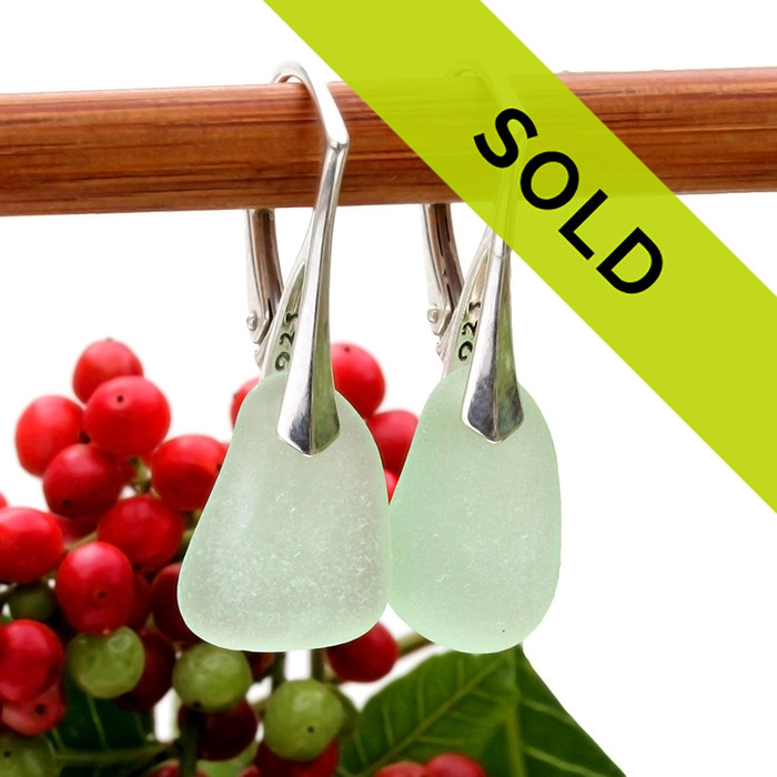 A pair of natural surf tumble sea glass earrings in a seafoam green on sterling leverbacks. Sorry these sea glass earrings are no longer available!