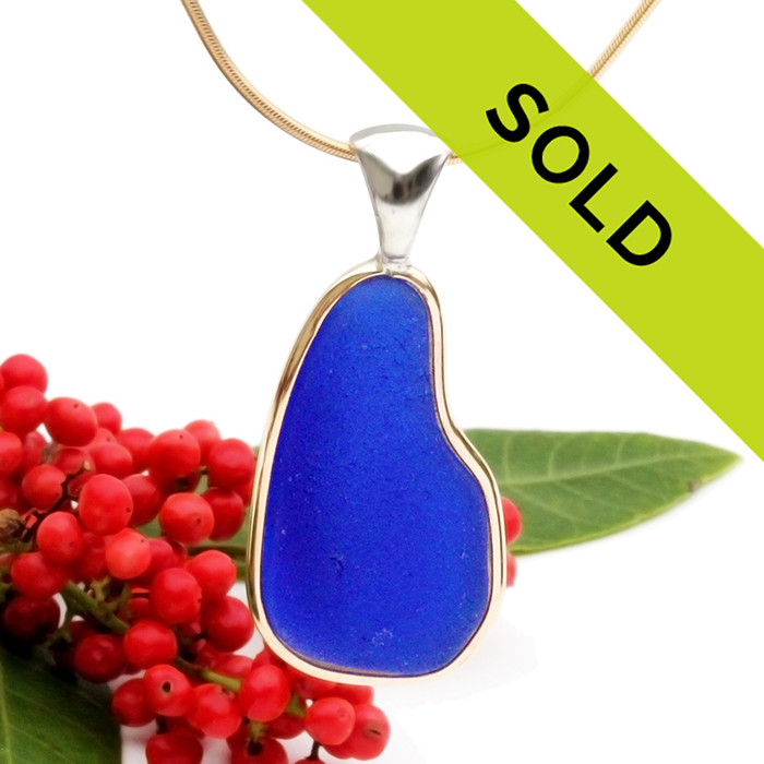 A perfect top quality piece of cobalt blue sea glass set in a mixed metal gold and sterling silver necklace. Sorry this sea glass jewelry piece has been sold!