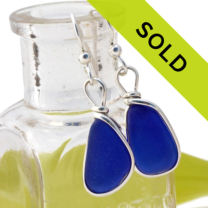 Vivid perfect cobalt blue sea glass pieces set in our Original Wire Bezel© earrings setting.  Sorry this sea glass jewelry selection has been sold!