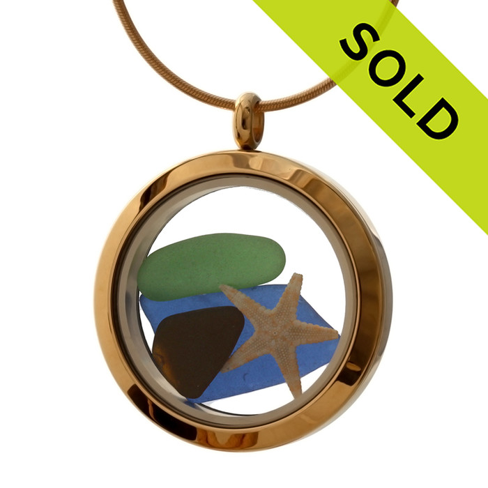 A gold tone stainless steel locket necklace with real beach found sea glass pieces and a real starfish! Strong magnetic locks secure your treasures inside. SOLD - Sorry this Sea Glass Locket is NO LONGER AVAILABLE!