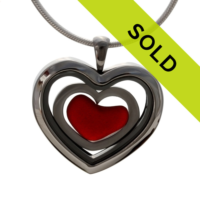 Red sea glass heart combined a large silver heart in this sea glass locket necklace. Sorry this piece has already sold!