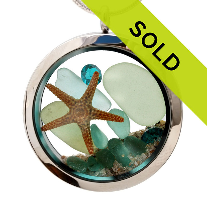 Blue and olive sea glass combined with a real starfish and brightened up a aquamarine gems . A great sea glass locket necklace for anyone, specially a March Beach Baby!  Sorry this sea glass jewelry piece has been sold!