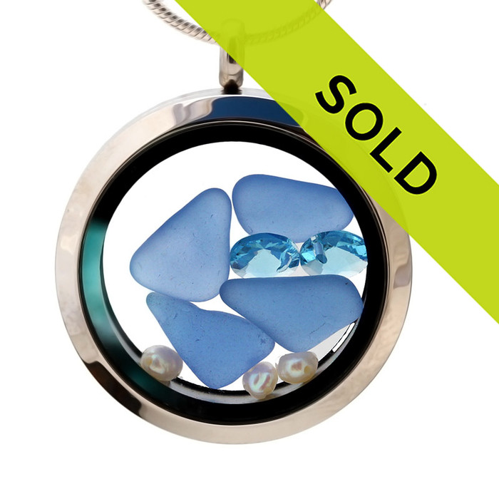 Light Blue beach found sea glass combined with a real freish water pearls and brightened up 2 large aquamarine gems . A great sea glass locket necklace for anyone, specially a March or June Beach Baby!