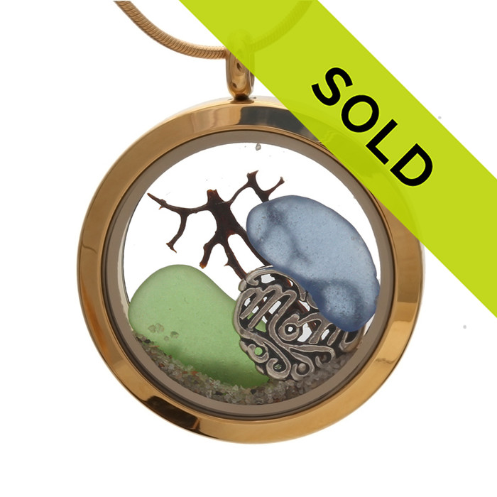 """A stunning goldtone stainless steel locket necklace with blue and green sea glass pieces and a """"MOM"""" Charm. Sorry this mothers day sea glass locket has been sold!"""