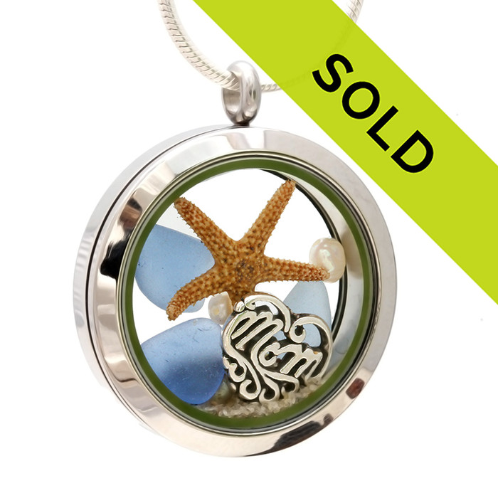 Pieces of genuine sea glass in light blue, a real starfish, fresh water pearls and a solid sterling MOM charm completes this sea glass locket necklace. Sorry this sea glass jewelry item has already been sold!