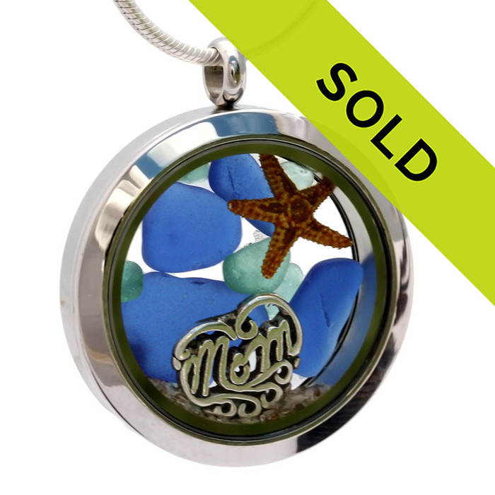 Beautiful  pieces of genuine blue sea glass  a real starfish, a bit of and a solid sterling MOM charm completes this sea glass locket necklace. Sorry this sea glass locket necklace has been sold!