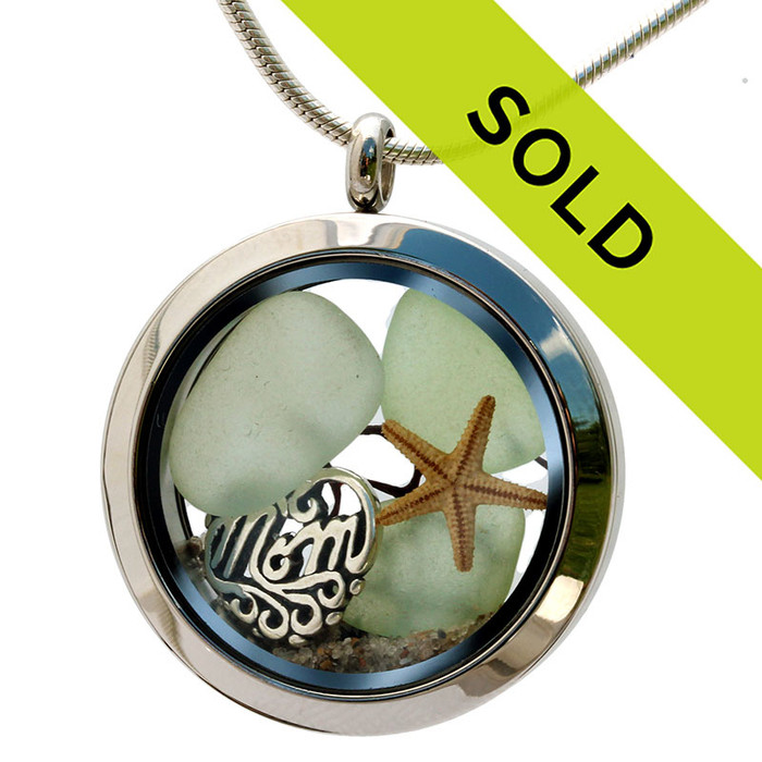 Beautiful  pieces of genuine seafoam Green  sea glass  a real starfish and a solid sterling MOM charm completes this sea glass locket necklace. Sorry this sea glass jewelry piece has been sold!