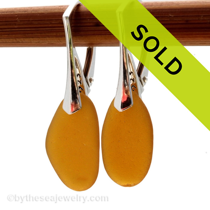 Bright Amber sea glass pieces shaped only by the sea, sand and time are suspended on solid sterling leverback earrings. Sorry this sea glass jewelry selection has been sold!