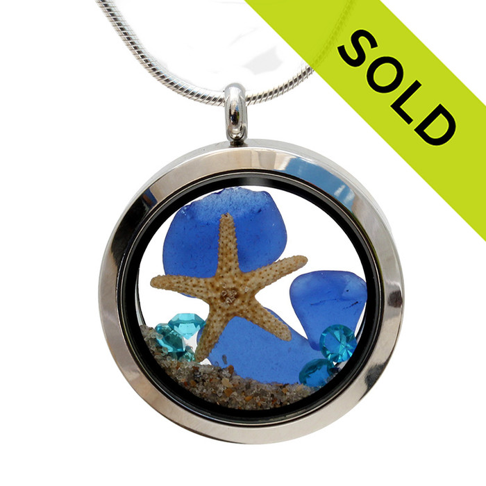 A beautiful pieces of natural blue sea glass combined in a stainless steel locket necklace with a two real starfish and beach sand. Sorry this Sea Glass Jewelry selection has been SOLD!