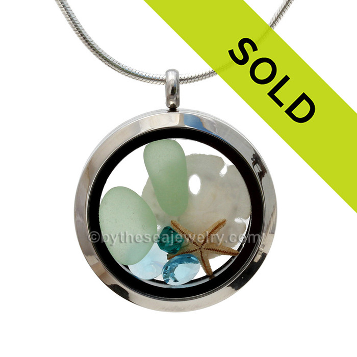 Genuine seafoam green sea glass pieces combined with a small real sandollar , starfish and aquamarine gems. Sorry this sea glass jewelry selection has been sold!