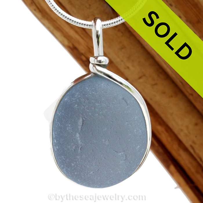 A stunning gray blue sea glass in a classic timeless setting. Sorry this sea glass necklace pendant has been sold!