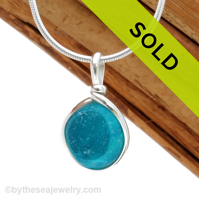 A beautiful smaller piece of electric mixed turquoise or aqua English Multi sea glass set for a necklace in our Original Sea Glass Bezel© in solid sterling silver setting. Sorry this sea glass jewelry piece has been sold!
