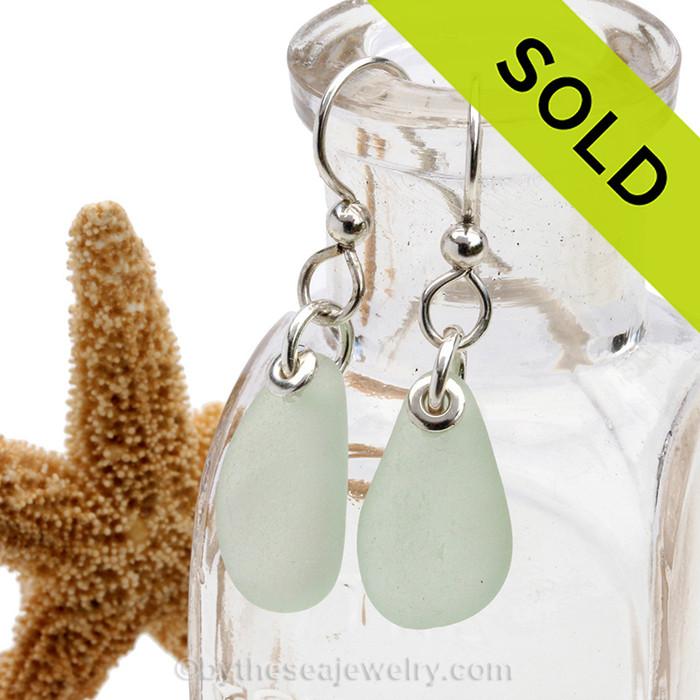 A perfect pair of simple seafoam green sea glass earrings are set on sterling silver fishook earrings.