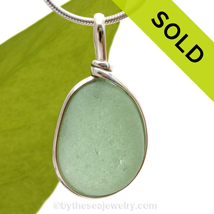 A beautiful PERFECT piece of seafoam green sea glass set in our Original Wire Bezel pendant setting.  Sorry this Sea Glass Necklace Pendant has been SOLD!