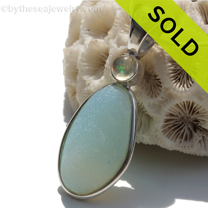 This beautiful HIGHLY RARE Opalized Seaham sea glass piece is set in our Deluxe Wire Bezel© pendant setting. This incorporates a Genuine Opal set in a bezel setting for a touch of elegance. Sorry this sea glass jewelry selection has been sold!