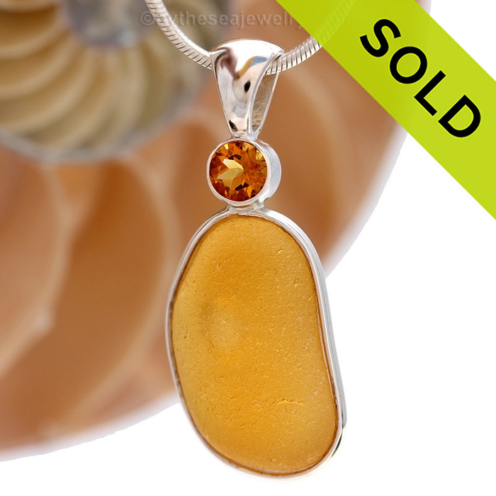 This beautiful Bright Vivid Golden  sea glass pendant is set in our Deluxe Wire Bezel© pendant setting with a genuine Citrine Faceted gem. Sorry this one of a kind sea glass jewelry piece has been sold!