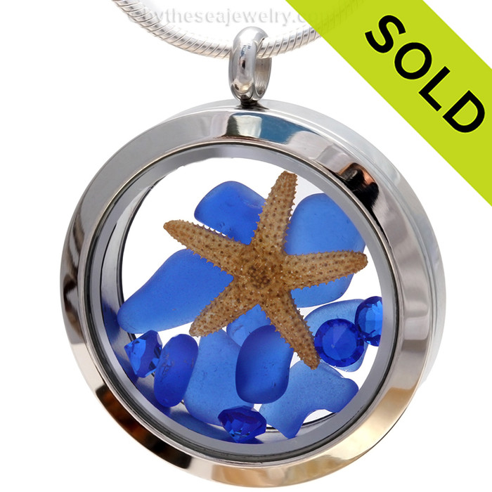 A beautiful pieces of natural blue sea glass combined in a stainless steel locket necklace with a real starfish & Sapphire crystal Gems. Sorry this Sea Glass Jewelry piece has been sold!