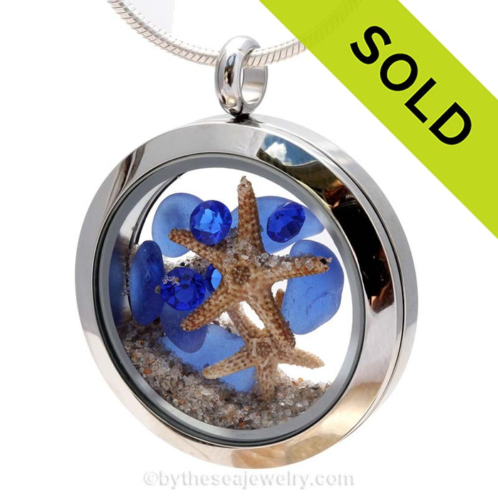 A beautiful pieces of natural blue Sea Glass Locket combined in a stainless steel locket necklace with two real starfish & Sapphire crystal Gems. Sorry this Sea Glass Jewelry selection has been SOLD!