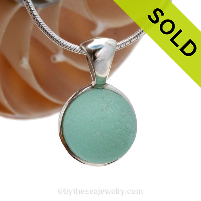 A stunning aqua sea glass Codd marble mixed in our Deluxe Wire Bezel© pendant setting. Sorry this Ultra Rare Sea Glass Pendant is no longer available.!