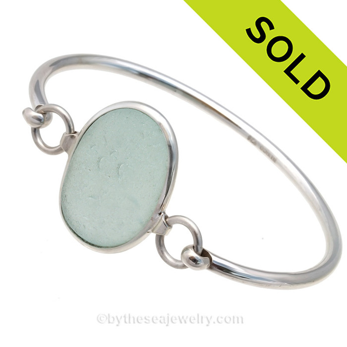 Genuine Seafoam Green Sea Glass Bangle Bracelet set in our Deluxe Wire Bezel© sterling silver setting. Sorry this Sea Glass Jewelry selection is no longer available.