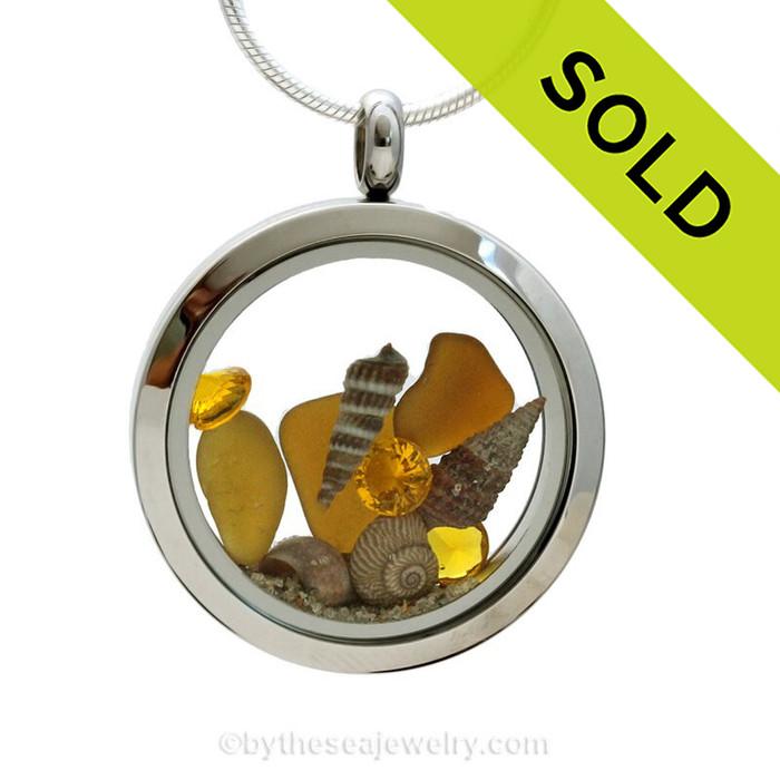 November Beach Lover-  Amber Genuine Sea Glass Locket With Shells and Topaz Gems