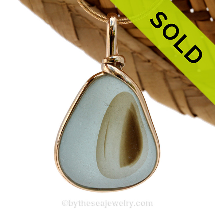 A stunning Seaham Sea Glass mutli in a pale blue and harvest brown set in our Original Wire Bezel Pendant setting in 14K Goldfilled. Sorry this piece of Sea Glass Jewelry is no longer available.