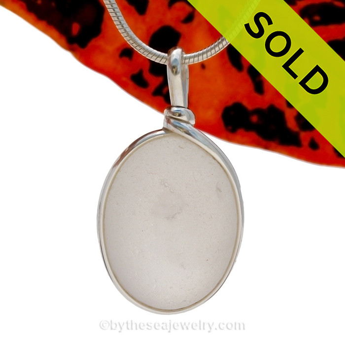 A larger piece of pure white sea glass in a naturally shape. This piece is set in our Original Wire Bezel© in sterling silver. SOLD - Sorry this Sea Glass Pendant is NO LONGER AVAILABLE!