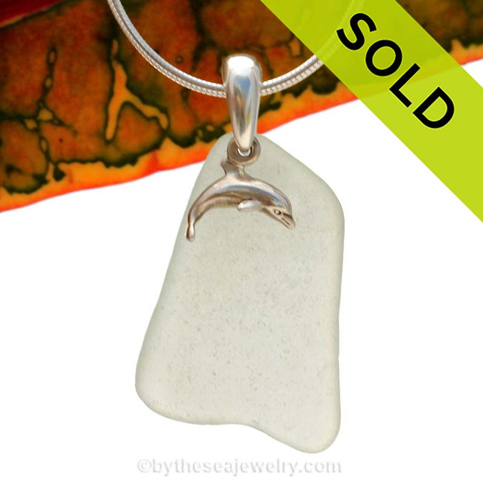 Beach found smaller sea green sea glass is combined with a solid sterling dolphin charm and presented on an 18 Inch solid sterling snake chain.