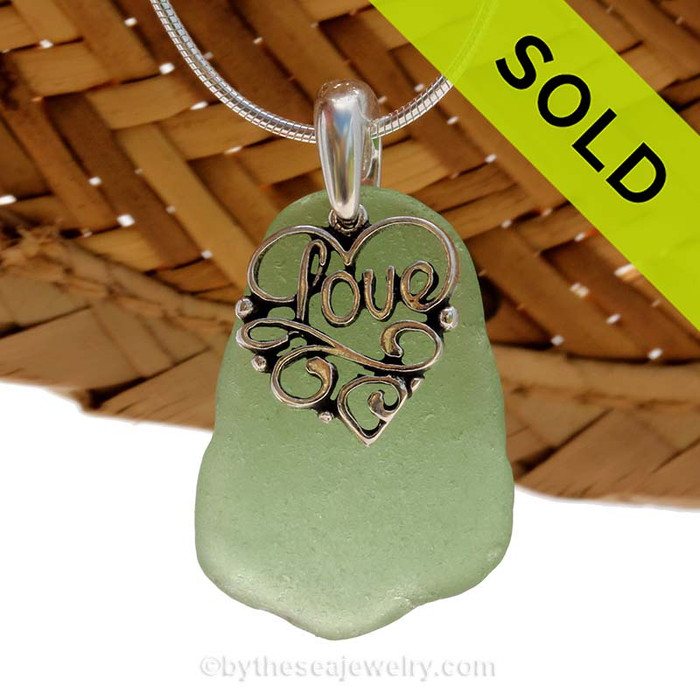 """A nice larger piece of green genuine sea glass necklace with a solid sterling bail and detailed """"Love"""" heart charm. Sorry this Sea Glass Jewelry selection has been SOLD!"""